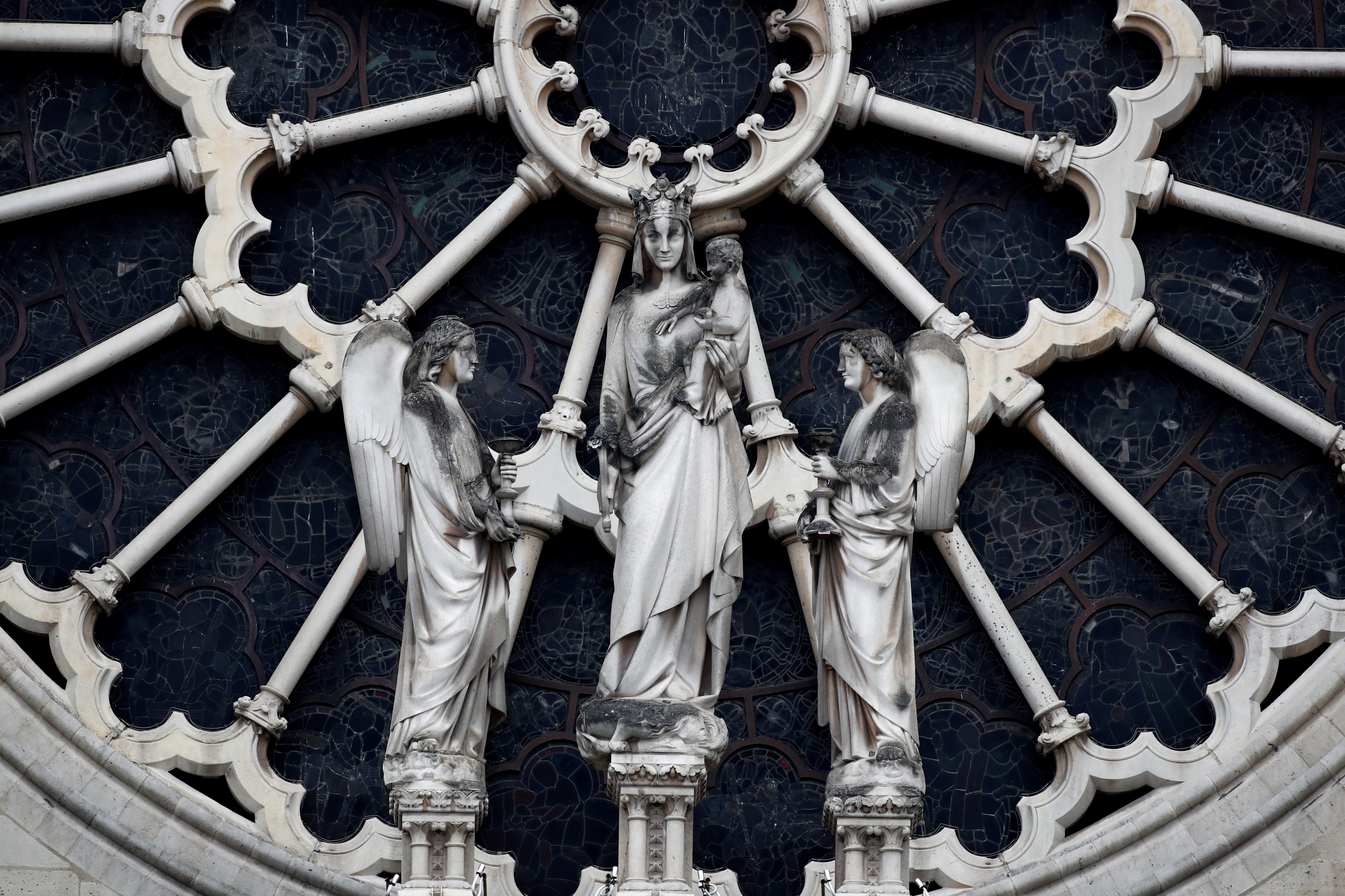 Notre-Dame's famed rose window spared but blaze harms priceless