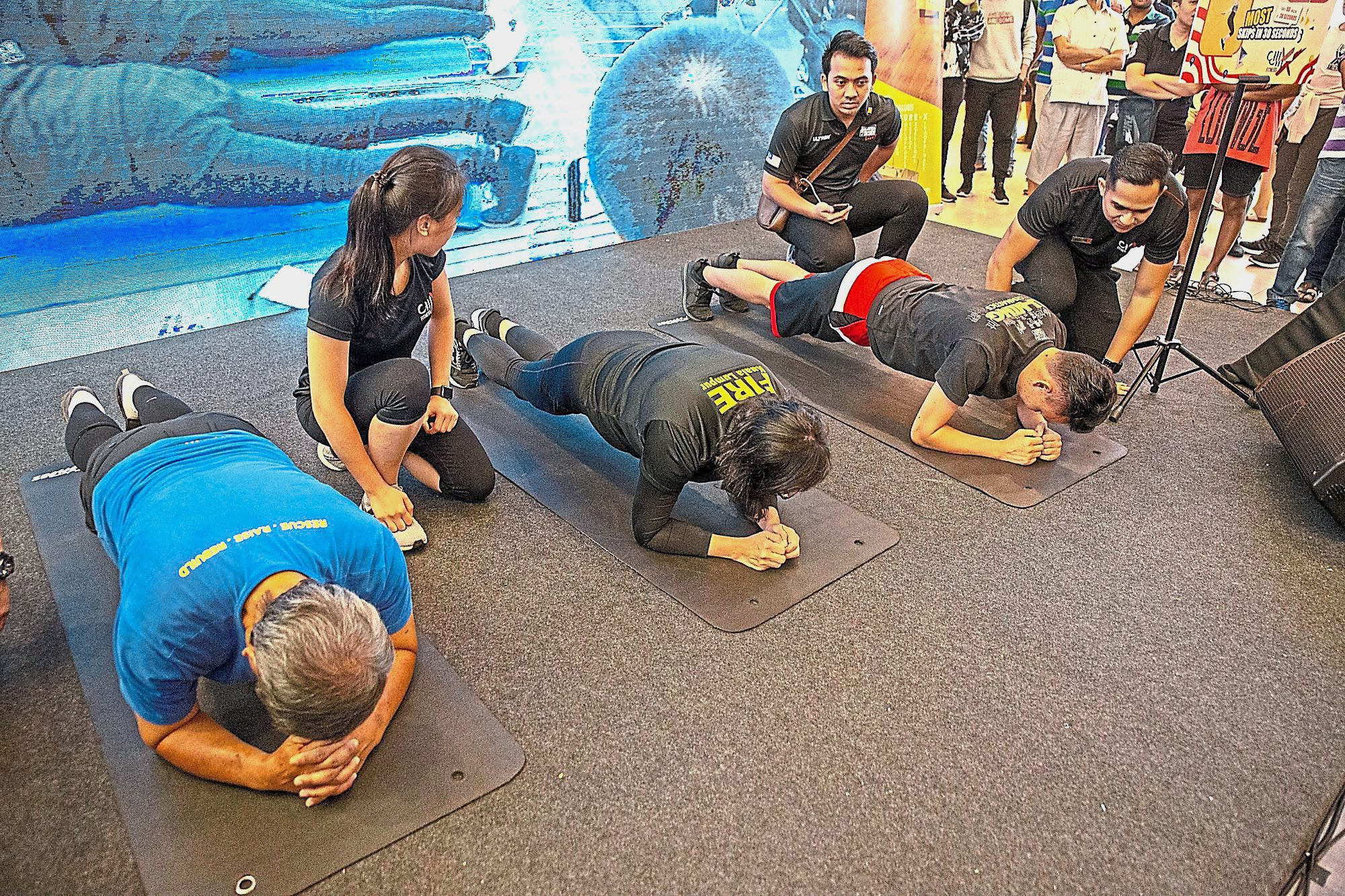 Participants in the Longest Duration Plank challenge trying to break the one-hour mark. Despite their attempts, none could break the record.