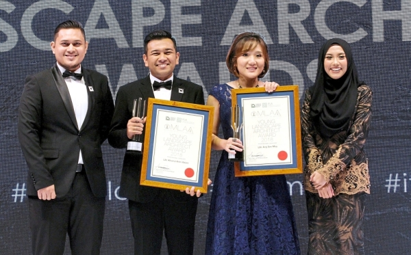 MLAA Young Landscape Architect Award winners Khairul Amri Adam (second from left) and Ang See May (second from right) receiving their awards from the previous year's winners Muhamad Zaedi Mohd Asri (left) and Syamim Azhari.