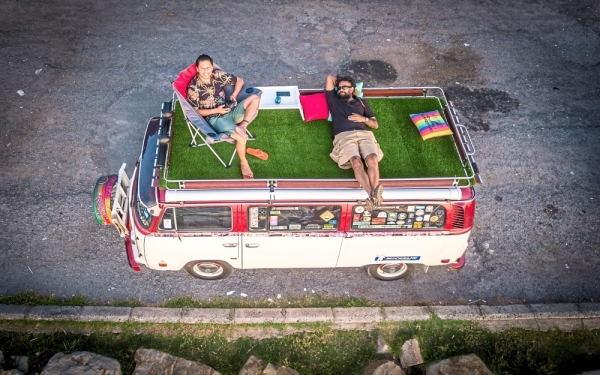Suchen (right) and his guest relaxing on the roof rack out in Kota Kinabalu.