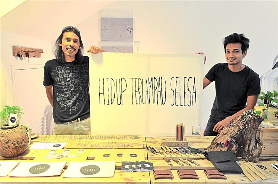 Rizal Sufar (left) and Izat Arif with Hidup Terlampau Senang, priced at RM2,500.