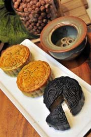 True to tradition: Some of Lavender Confectionery and Bakeryu2019s mooncakes, including one with bamboo charcoal skin. Lavender stands by its classic mooncakes which is believed to be the essence of the Mid-Autumn Festival.