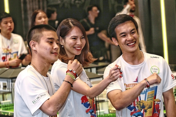 Far left: (From left) IDO TSHIRT designer and Stoned & Co founder Andrew Ngo, National Cancer Society of Malaysia youth ambassador Choo Mei Sze and EcoWorld executive director Liew Tian Xiong showing their support for #AnakAnakMalaysia.