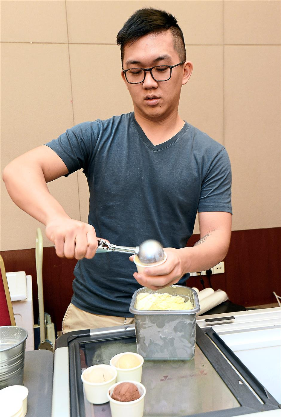 Creamy treat: A man serving ice cream at the Forty Licks booth.