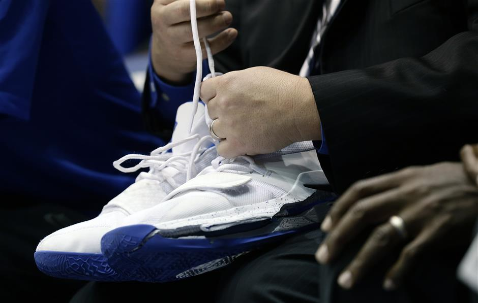 A trainer holds Duke\'s Zion Williamson\'s shoes after Williamson left the game due to an injury during the first half of an NCAA college basketball game against North Carolina in Durham, N.C., Wednesday, Feb. 20, 2019. Duke might have to figure out what the Zion Show will look like without its namesake. All because of a freak injury to arguably the most exciting player in college basketball. As his Nike shoe blew out, Williamson sprained his right knee on the first possession of what became top-ranked Duke\'s 88-72 loss to No. 8 North Carolina. (AP Photo/Gerry Broome)