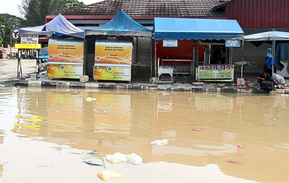 Water everywhere: Part of the road at Arena Square is still flooded.