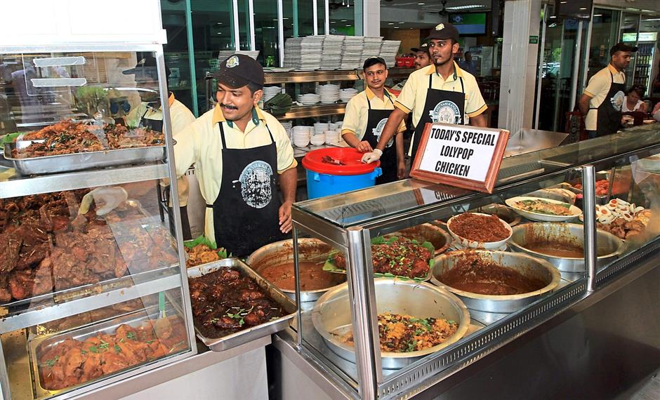 Good food and good company makes Orginal Penang Kayu Nasi Kandar a good place for family and friends, no matter the day. Prize presentation for Star Food Awards best Nasi Kandar to Kayu Nasi Kandar. ......Sam Tham/Star