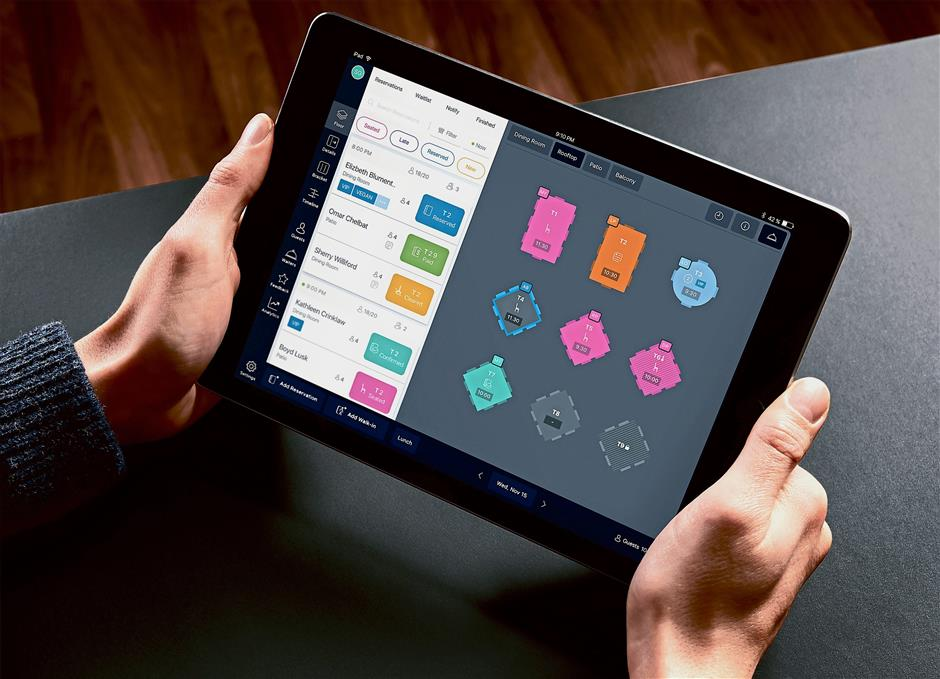 A sample of the table management software by Umai, available on mobile devices and desktop. — Photos: Umai