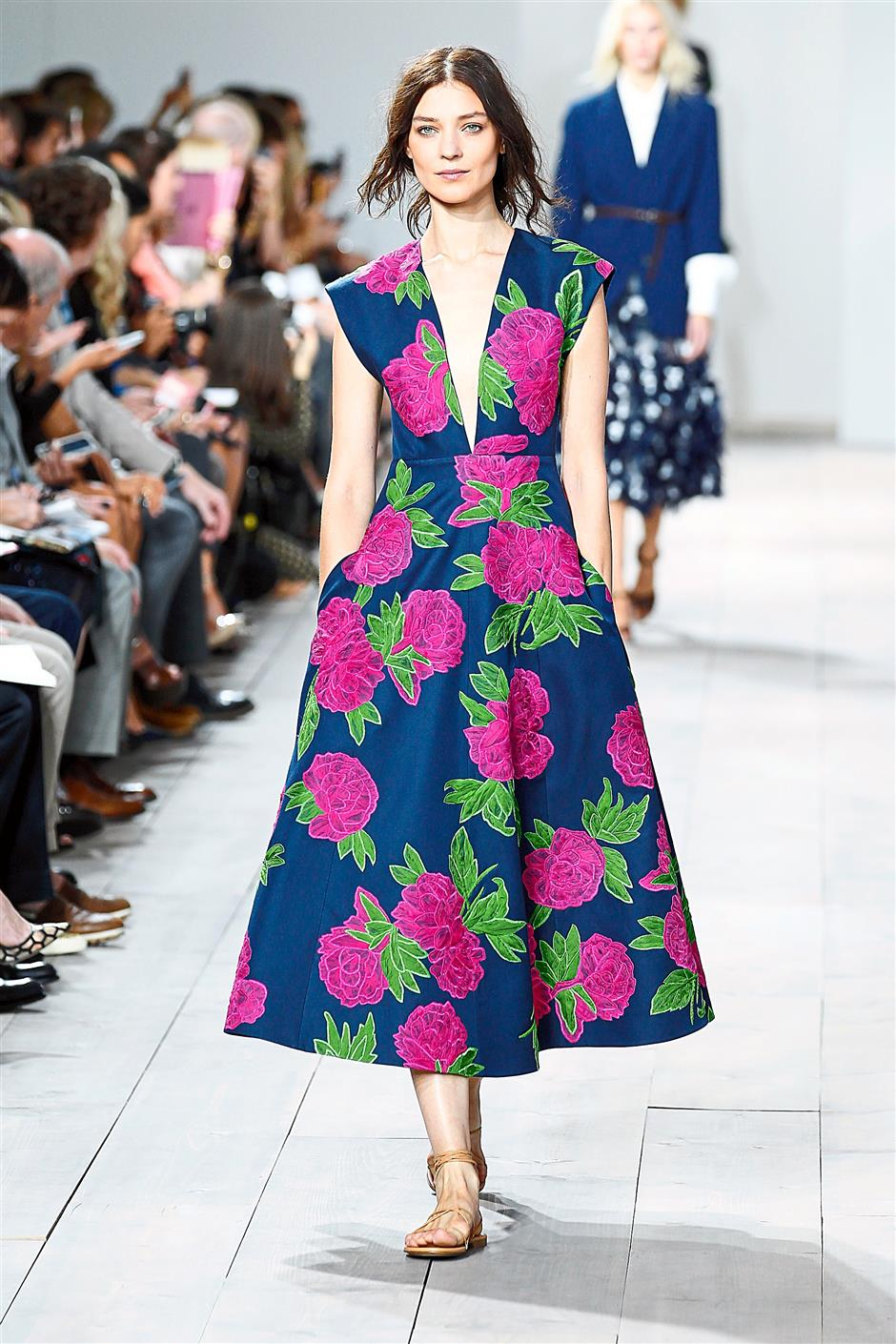 A navy midi dress with magenta blooms and plunging V neckline.