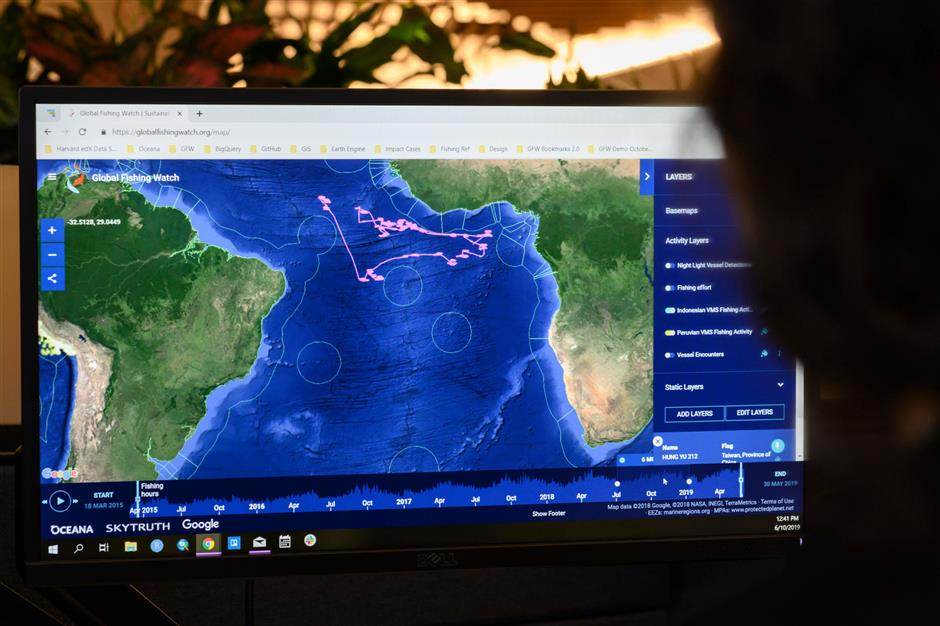 Lacey Malarky, an Oceana campaign manager on illegal fishing and transparency, monitors the GPS position of a fishing boat in the Atlantic ocean from her computer at the headquarters of the NGO Oceana on June 10, 2019 in Washington, DC. - From her desk in a building in downtown Washington, Lacey Malarky monitors fishing vessels that take advantage of the vastness of Earth\'s oceans to cheat in the belief that no one is watching. Malarky uses a website called Global Fishing Watch, which was launched by her employer, the NGO Oceana, with Google and a nonprofit called SkyTruth less than three years ago to trace where 70,000 fishing vessels have sailed since 2012. (Photo by Eric BARADAT / AFP)