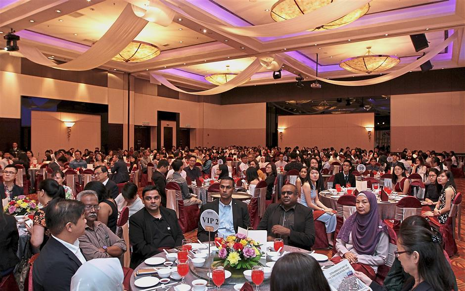 Thirty tables in the Eastin Hotel ballroom in Petaling Jaya were filled with honoured guests enjoying the eight-course lunch with the delicious anniversary cake as the dessert. Photos: AZHAR MAHFOF, AZMAN GHANI and YAP CHEE HONG/The Star