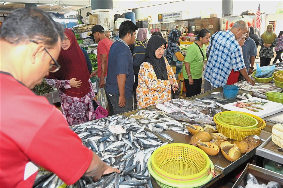 The price of fish went down during the fasting month as the demand is lower.