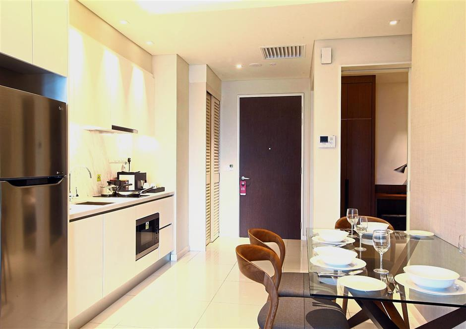 Rooms are equipped with kitchen complete with facilities such as washer/dryer, microwave oven and fridge.