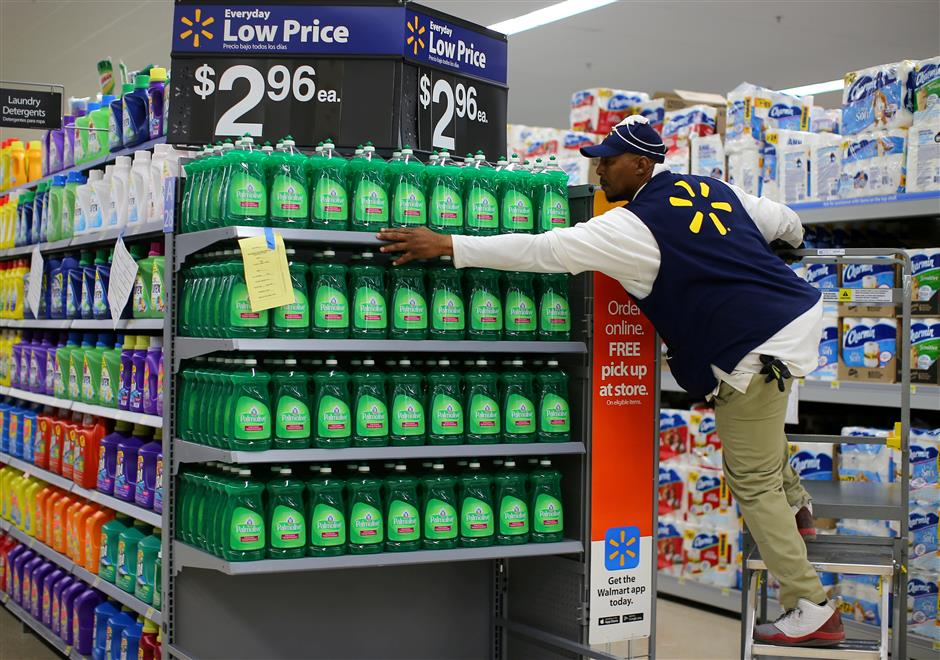 FILE PHOTO: A worker sets up a display of dish washing liquid in prepare for the opening of a Walmart Super Center in Compton, California, U.S., January 10, 2017. REUTERS/Mike Blake/File Photo