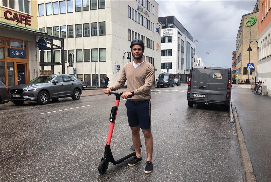 Fredrik Hjelm, Swedish startup VOI co-founder and chief executive displays one of his electric scooters on the street in Stockholm, Sweden July 6, 2019. Picture taken July 6, 2019. REUTERS/Esha Vaish