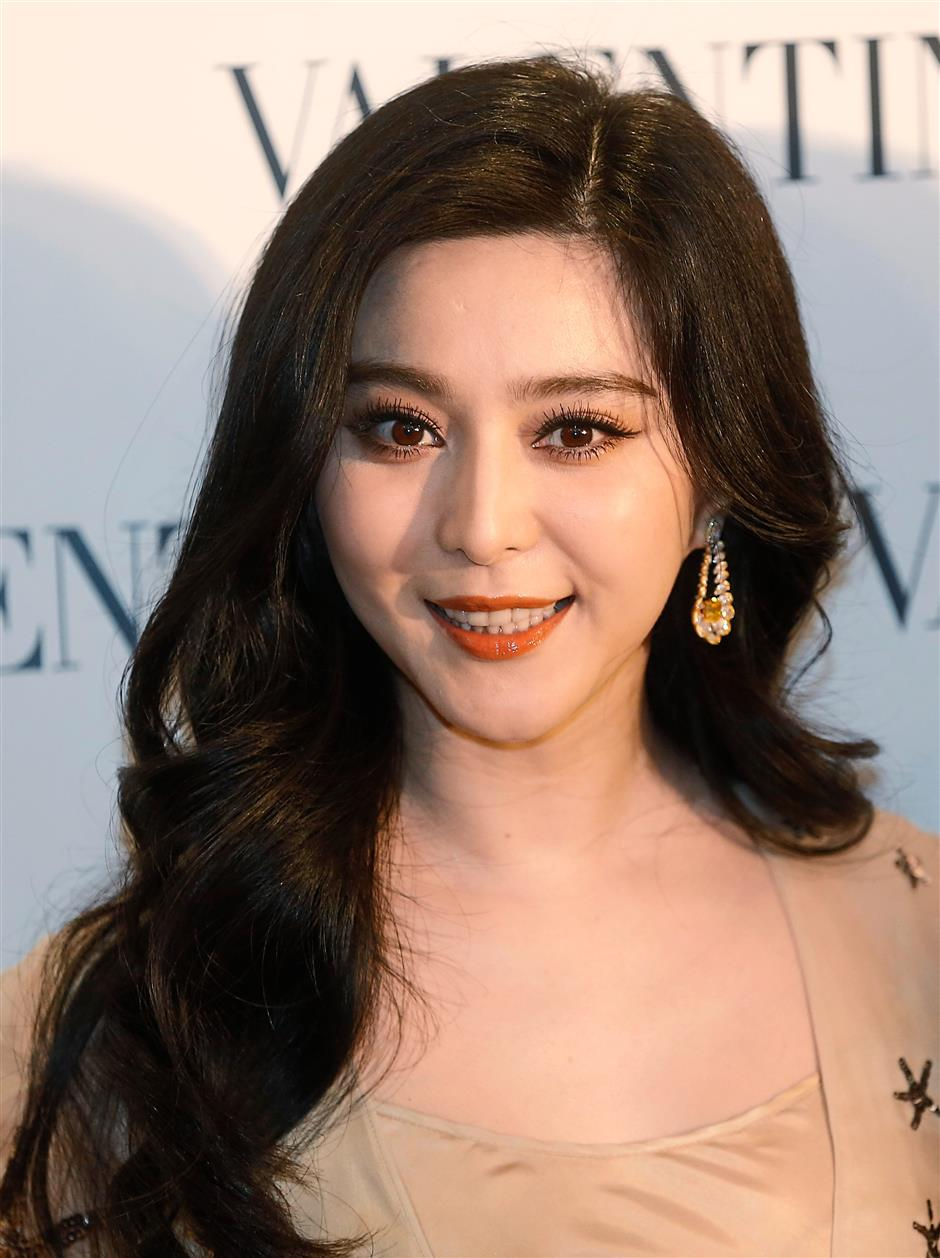 Chinese actress Fan Bingbing poses during a promotional event for the opening of a new store of fashion brand Valentino in Hong Kong Thursday, Feb. 5, 2015. (AP Photo/Kin Cheung)