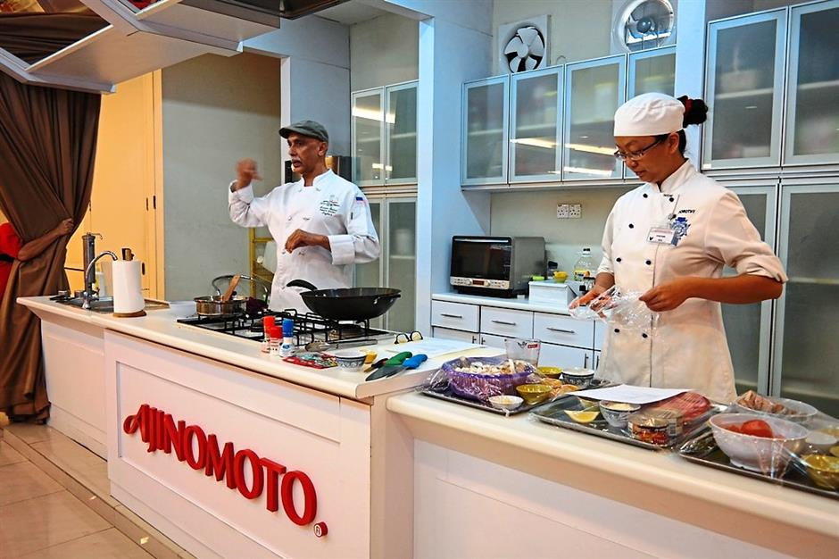 Sharing some tips: Chef Karamvir Singh Godrei showing his technique during a cooking demonstration.