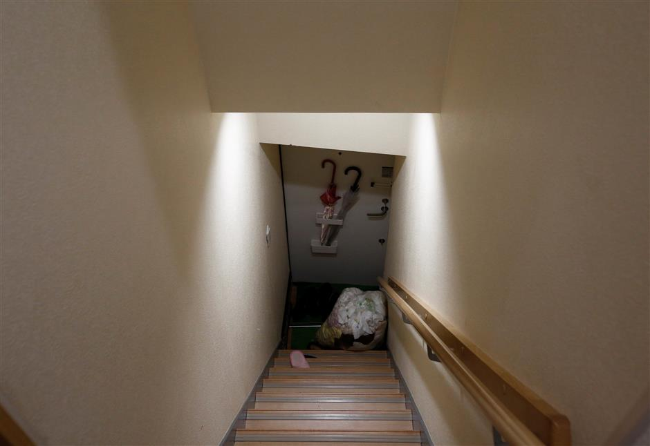 A sack containing laundries is placed on a stair at an apartment which is used as Airbnb service after customers checked out in Tokyo, Japan March 12, 2018. Picture taken March 12, 2018.  REUTERS/Kim Kyung-Hoon
