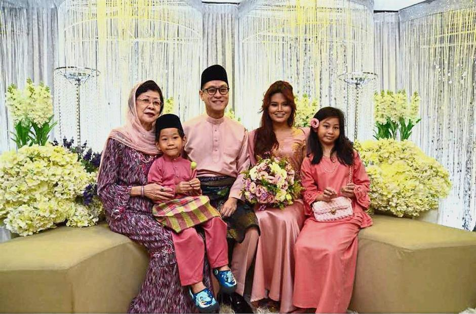 Engaged: Zairil with Dyana and Zairil's mother Puan Sri Christine Khir Johari, son Riahn and daughter Emmalyn.