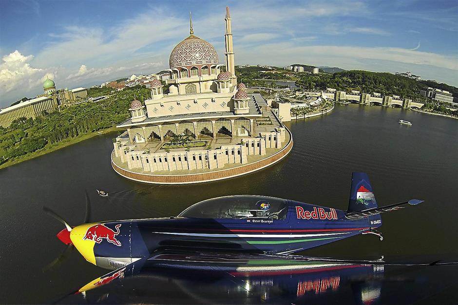 Peter Besenyei puts the Red Bull stunt plane through a demo around Putrajaya.