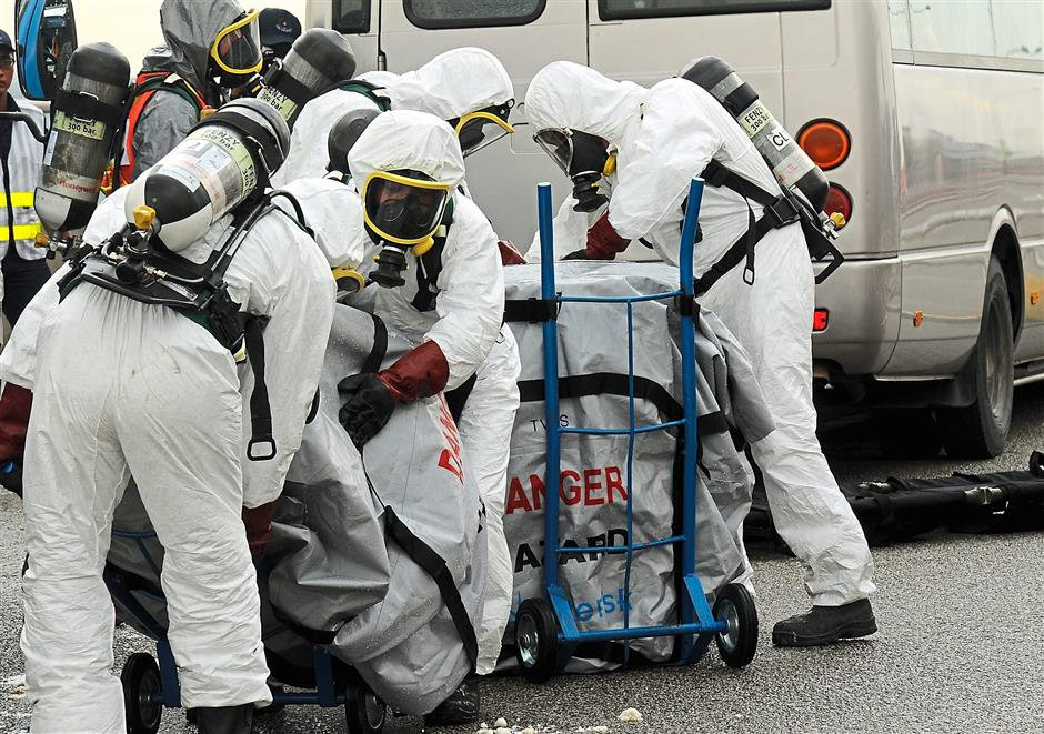 Practice: The recovery team from Malaysia Pridechem trying to clean up chemical substances during the mock drill at the Second Link bridge.