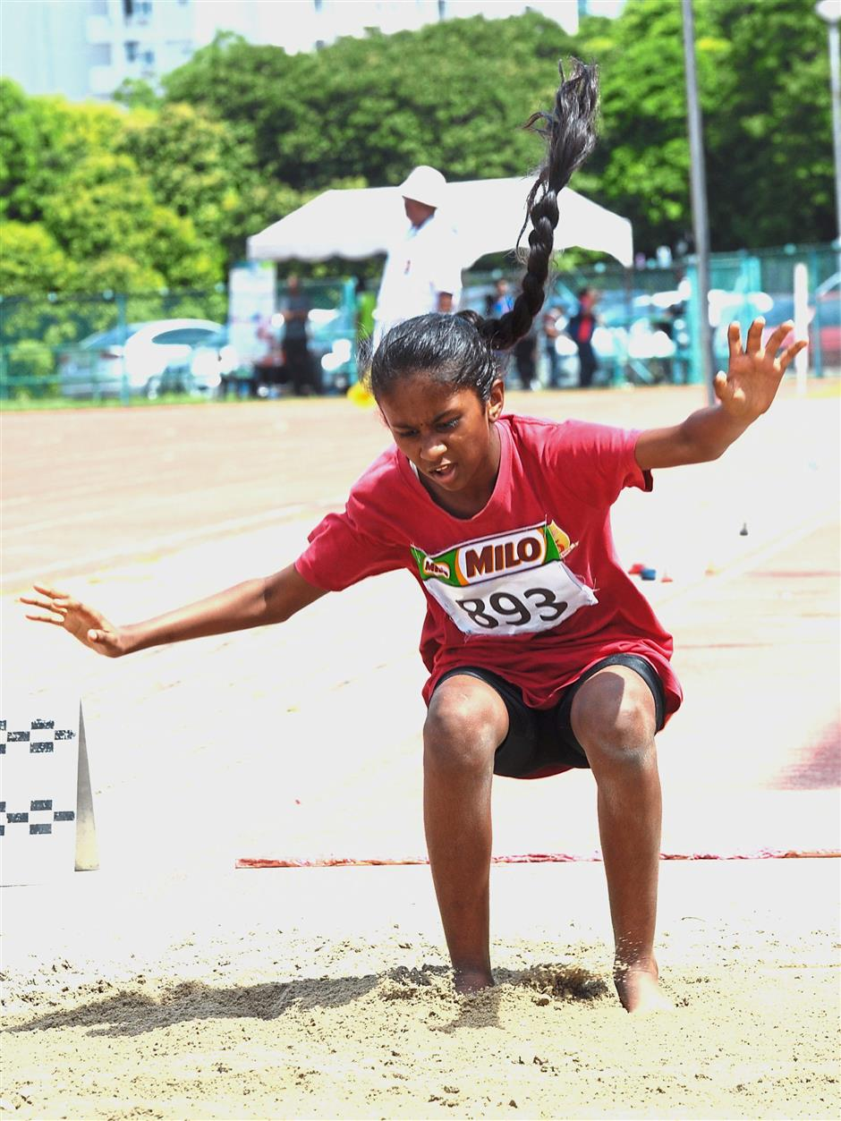 An athlete taking part in the long jump event.