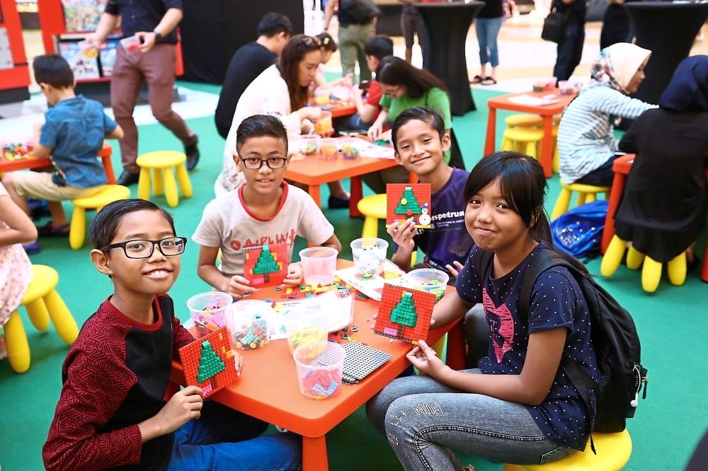 Children from MyKasih Foundation showing their Lego mosaics.