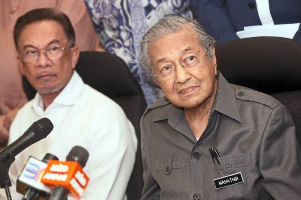 Big debate: Dr Mahathir (right) and Anwar at a recent press conference. Questions about when exactly PM-in-waiting Anwar will take over have persisted despite the official timeline of two years given by PH before last yearu2019s election. u2014 IZZRAFIQ ALIAS/The Star