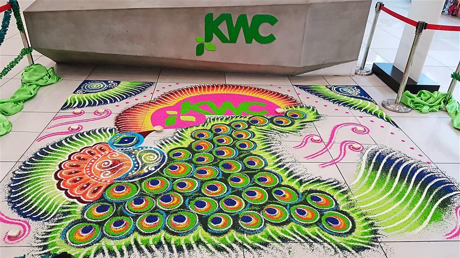 Peacock kolam designs welcome shoppers at Kenanga Wholesale City