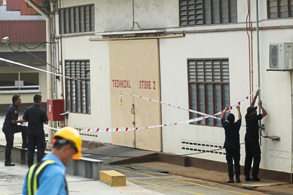 The factory in Semenyih being sealed by Kajang Municipal Council after it was found guilty of polluting a nearby river. — AZMAN GHANI/The Star