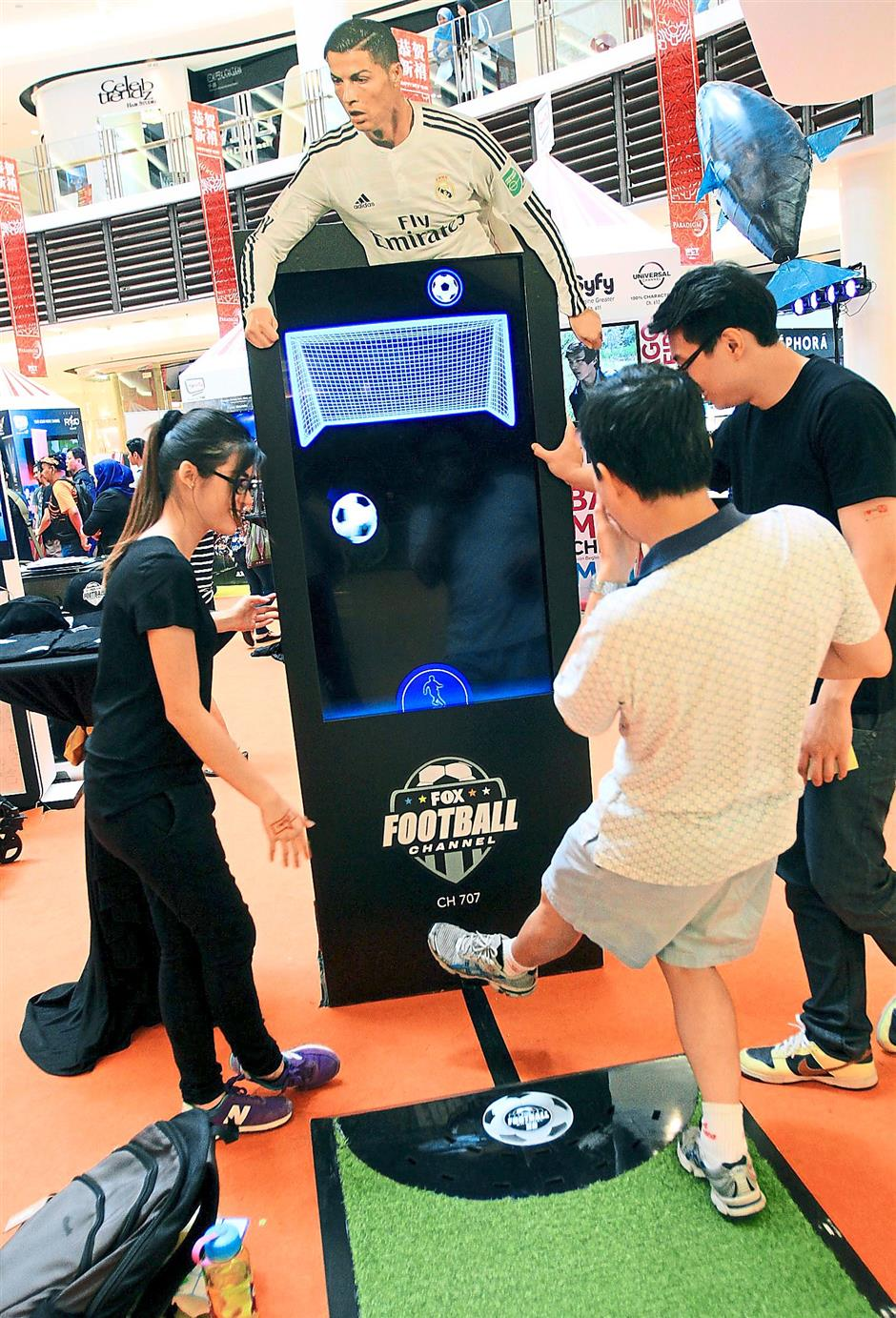 Just like Ronaldo: Guests putting their skills to test at the virtual football simulator, which was set up to introduce the numerous sports channels by HyppTV.