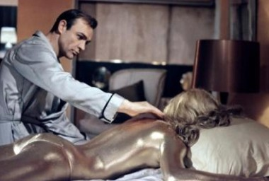 All that glitters is gold, as Bond (Sean Connery) discovers in Goldfinger.