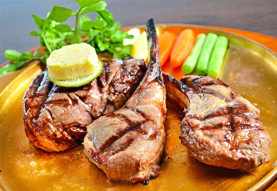 Angus Houses Steak Combo - a pairing of beef tenderloin and lamb rack, charbroiled to tender, juicy perfection. (Jeremy Tan / Sept 24, 2013)