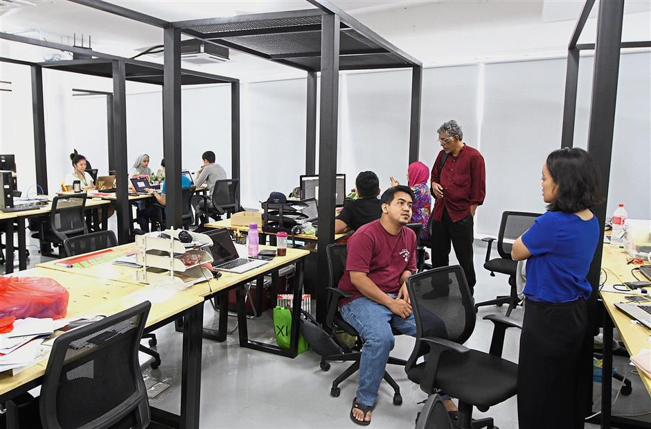 Invoke Malaysia staff at work at the election campaigning institution's headquarters in Sungai Besi, Kuala Lumpur.