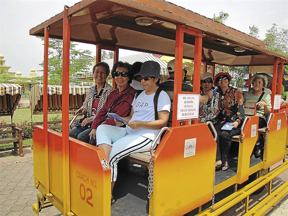 SECITA members on a tram ride on the grounds of the Crystal Mosque in Kuala Terengganu, Terengganu.