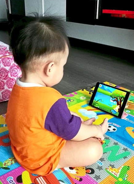 (Left) Even something as simple as playing with bubbles can be a great learning activity. (Far left) Toddlers should be discouraged from using the smartphone for long periods of time.