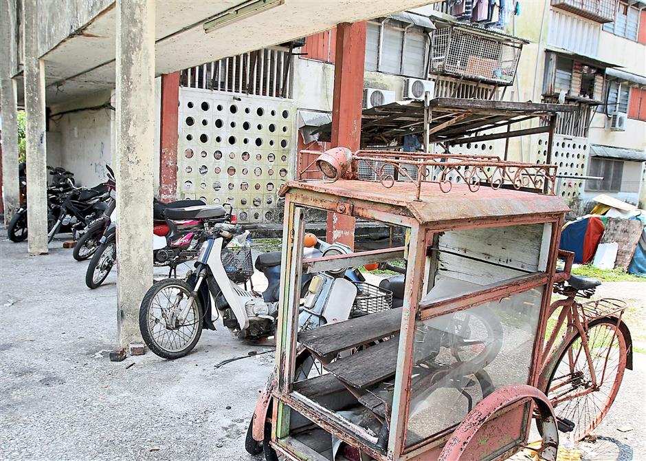 Eyesore: Some of the motorcycles left abandoned at the flat's parking area.