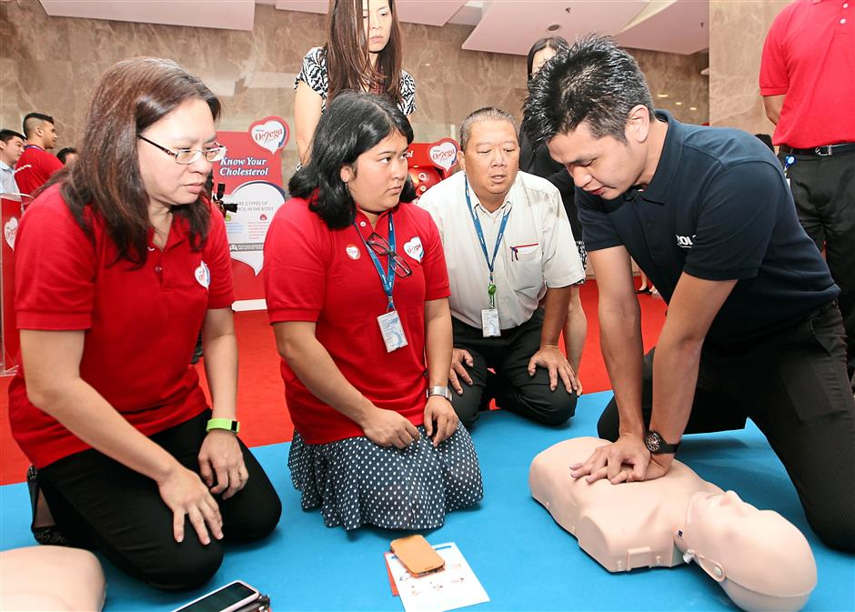 Guests learning how to conduct the life-saving cardiopulmonary resuscitation (CPR) technique to revive a cardiac arrest victim.