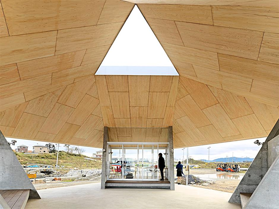 Home For All in Kesennuma, Tohoku region, Japan. The geometry of the galvanised steel roof creates a dome-like space beneath and the Japanese cypress plywood cladding underneath creates a warm and protective atmosphere inside the pavilion. At night, the building glows warmly from within, like a lighthouse, waiting for fishermen to come back. - Jonathan Leijonhufvud