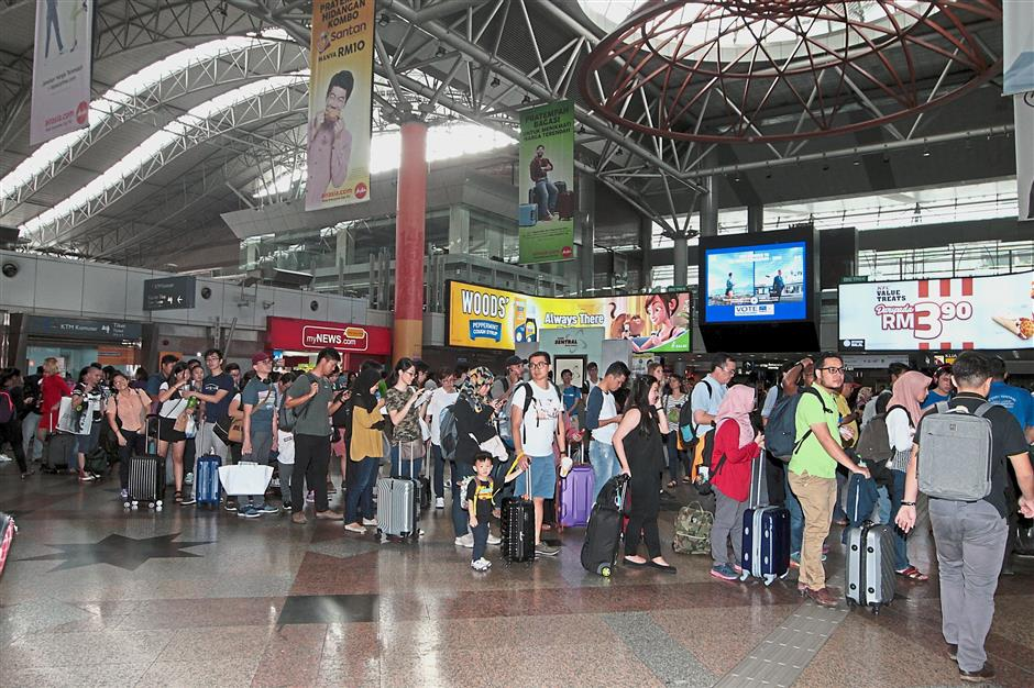 All set to travel: People queuing to buy KTM tickets at KL Sentral.