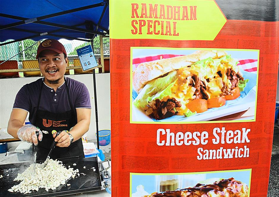 The smell of onions over fried with chicken meat at the SS13 bazaar attracted customers to the Mexican inspired food stall set up by Noor Firdaus Abu Mansor and his brother. The ramadan bazaar in SS13/1a, Subang Jaya on July 2, 2014. FAIHAN GHANI/The Star.