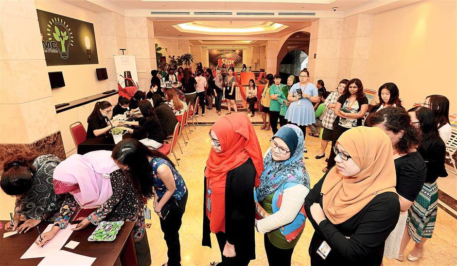 Good turnout: Female employees lining up to register for the lucky draw at the Menara Star lobby.