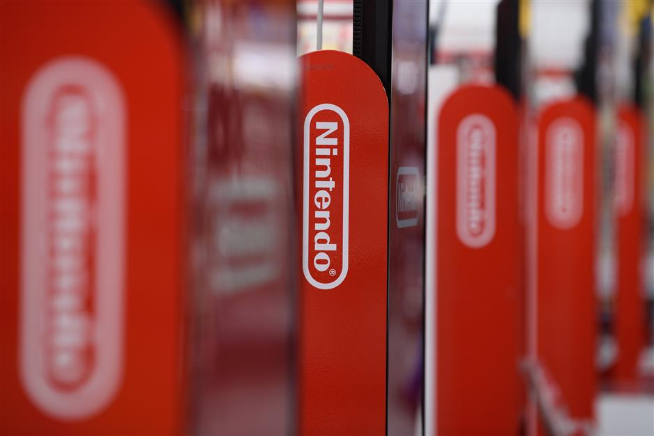 The Nintendo Co. logo is displayed inside a Yodobashi Camera Co. store in the Akihabara district of Tokyo, Japan, on Friday, April 12, 2019. Nintendo'su00a0Labo VR Kit, which went on sale Friday and starts at $40, is a build-it-yourself set of cardboard goggles and controllers for the company's Switch console.u00a0Photographer: Akio Kon/Bloomberg