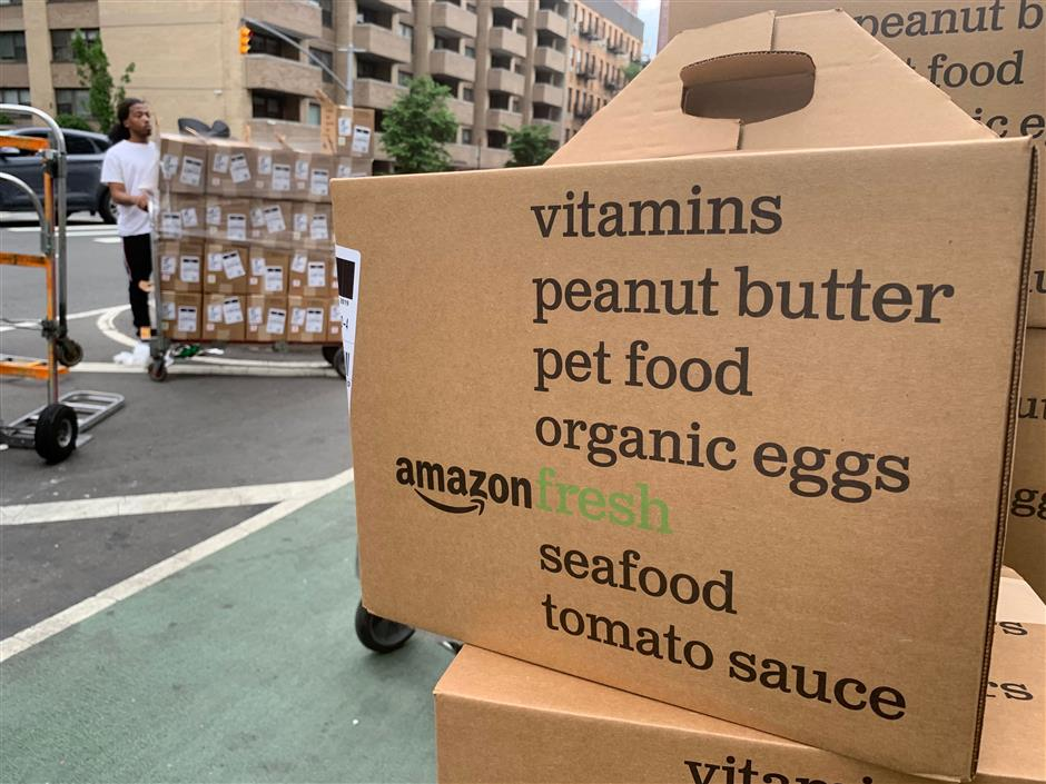 In this Sunday, June 16, 2019, boxes of Amazon Fresh deliveries are unloaded in New York. If you arenu2019t already tracking your spending, do so. Pay close attention to all the payments you make _ recurring or not _ and to the forms of payment: credit cards, Venmo, etc.  Subscription services are attractive because theyu2019re easy to sign up for and come with minimal monthly financial commitment, said researcher Dhaval Moogimane. But small costs can add up, and prices can increase over time.(AP Photo/Jenny Kane)