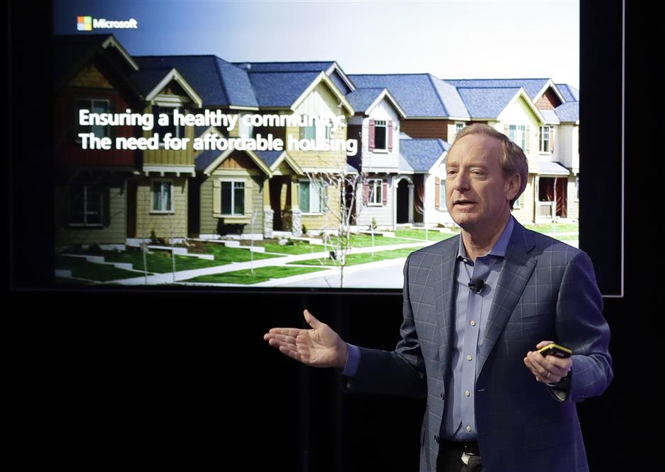 Microsoft Corp. President Brad Smith speaks Thursday, Jan. 17, 2019, during a news conference in Bellevue, Wash., to announce a $500 million pledge by Microsoft to develop affordable housing for low- and middle-income workers in response to the Seattle region\'s widening affordability gap and to also to address homelessness. (AP Photo/Ted S. Warren)