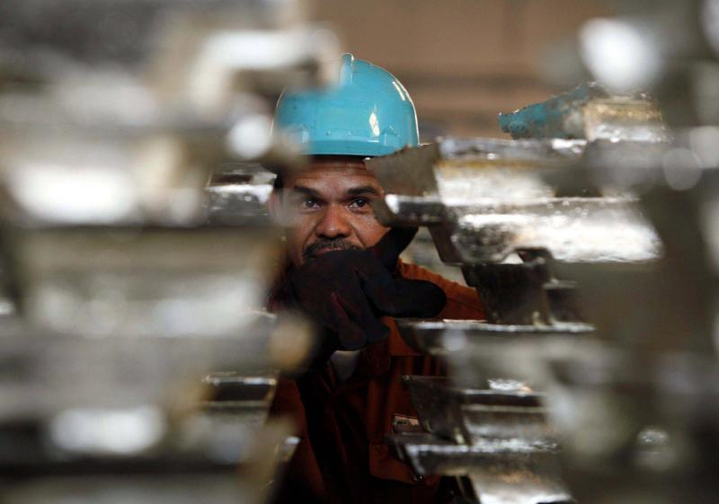 File photo of a worker counting ingots of tin at a PT Timah smelter in Mentok, on the Indonesian island of Bangka. At the end of August this year, Indonesia ruled that all tin ingot shipments should trade via a local platform, the Indonesia Commodity and Derivatives Exchange (ICDX), before being exported - Reuters Photo.