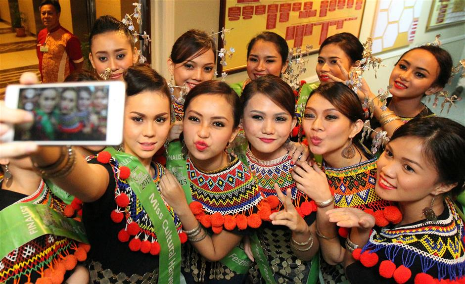 The finalists of the Miss Cultural Harvest Festival pageant posing for a selfie. - ZULAZHAR SHEBLEE / THE STAR