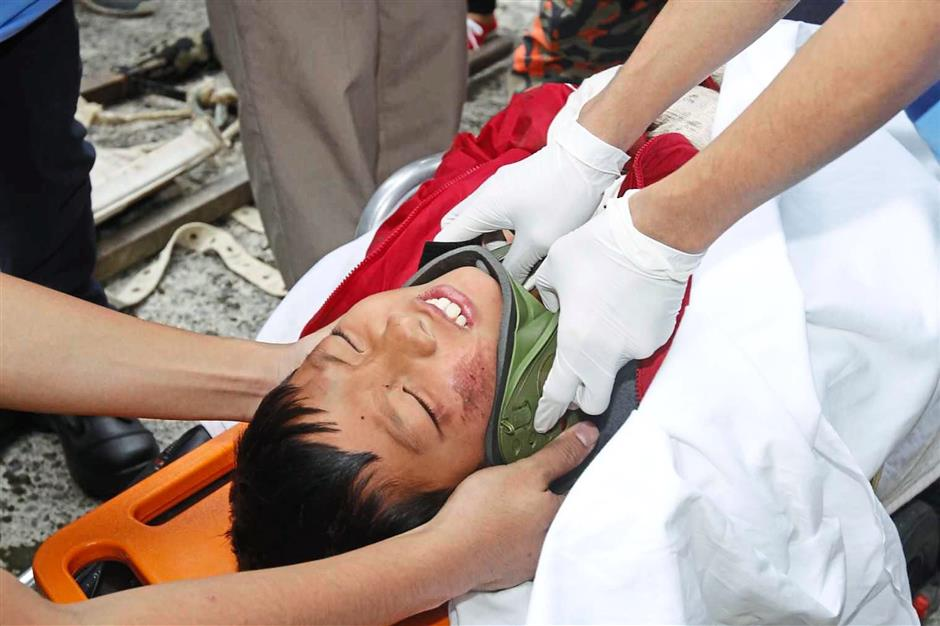 One of the injured climber Wafie , 11, of Singapore arrive at the Timpohon gate, Kinabalu Park, Kundasang yesterday. (June5) NORMIMIE DIUN/The Star