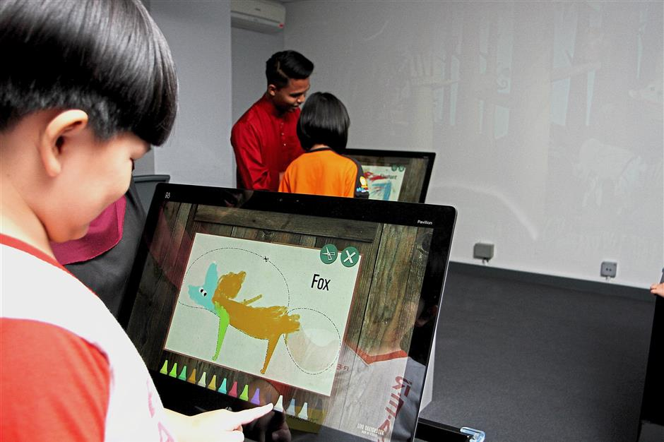 Children enjoying colouring pictures at the Live Sketch section.