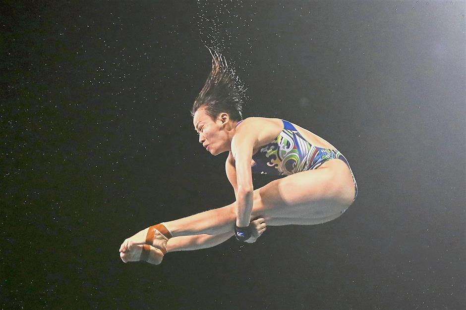 Right man for the job: Chinese coach Li Rui (inset) will be taking charge of elite women divers like Cheong Jun Hoong.